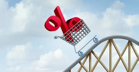 stijgende rente, procent teken in winkelwagentje, achtbaan